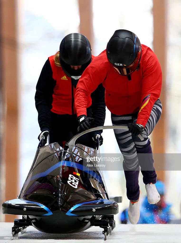 Sandra Kiriasis and Franziska Fritz of Germany practise a bobsleigh run ahead of the Sochi 2014 Winter Olympics at the Sanki Sliding Center on...
