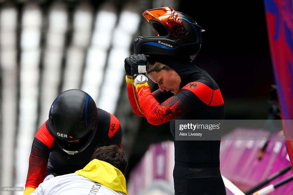 Sandra Kiriasis and Franziska Fritz of Germany team 1 look dejected during the Women's Bobsleigh on Day 12 of the Sochi 2014 Winter Olympics at...
