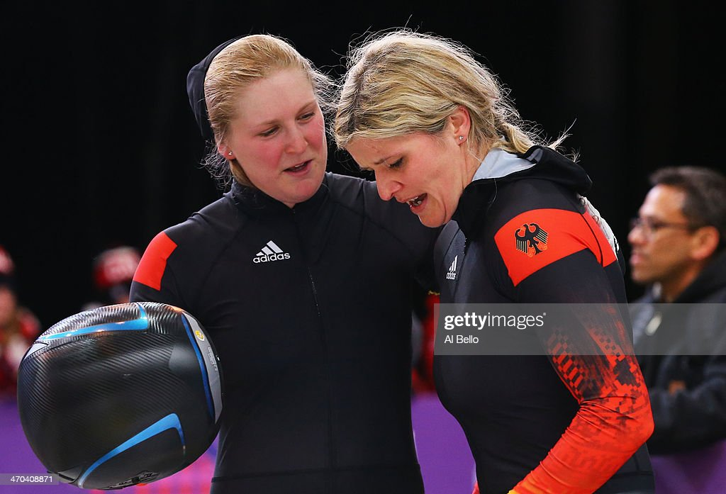 Sandra Kiriasis and Franziska Fritz of Germany team 1 talk during the Women's Bobsleigh on Day 12 of the Sochi 2014 Winter Olympics at Sliding Center...