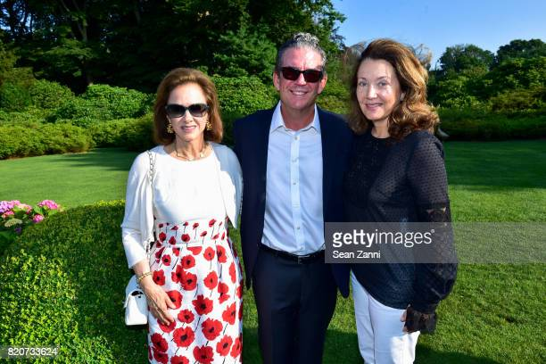 Sandra McConnell Brian McCarthy and Lisa McCarthy attend ARF in the Garden of Peter Marino at a Private Residence on July 15 2017 in Southampton NY