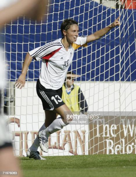 Sandra Minnert of Germany celebrates after scoring the second goal during the Women's FIFA World Cup qualifying match between Scotland and Germany on...