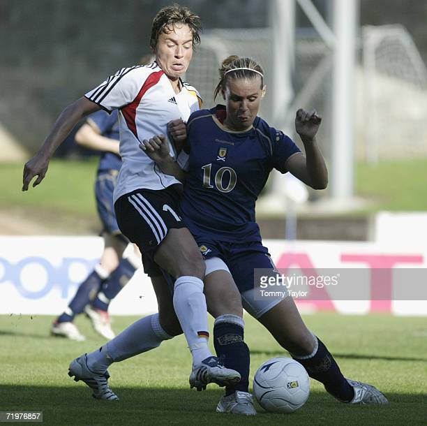 Sandra Minnert of Germany tackles Julie Fleeting of Scottland during the Women's FIFA World Cup qualifying match between Scotland and Germany on...
