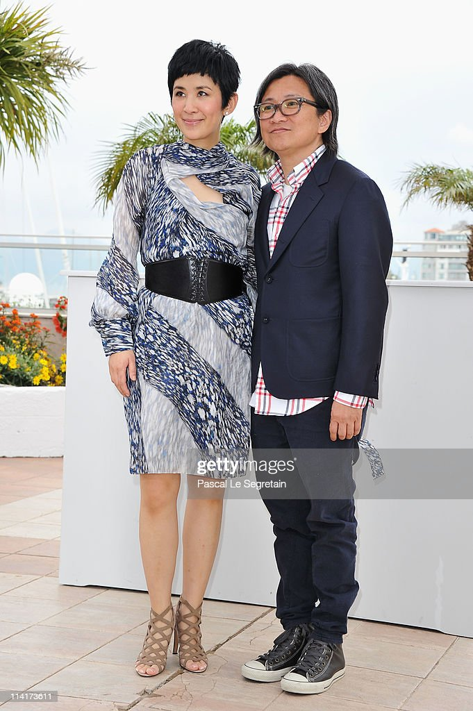 Sandra Ng Kwan Yu (L) and director Peter Chan attend the 'Wu Xia' Photocall at the Palais des Festivals during the 64th Cannes Film Festival on May 14, 2011 in Cannes, France.