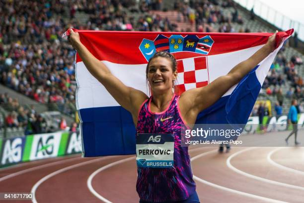 Sandra Perkovic of Croatia celebrates her victory in women's Discus Throw during the AG Insurance Memorial Van Damme as part of the IAAF Diamond...