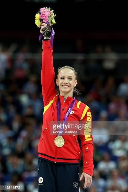 Sandra Raluca Izbasa of Romania celebrates with her gold medal during the medal ceremony following the Artistic Gymnastics Women's Vault final on Day...