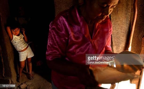 Sandra Rivera watches her grandmother Ermelinda Rivera make tortillas in their home in Unilde Sandra is the granddaughter of Santiago Rivera Coffee...
