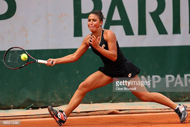 Sandra Samir of Egypt returns a shot during her girls' singles match against Fanny Stollar of Hungary on day nine of the French Open at Roland Garros...