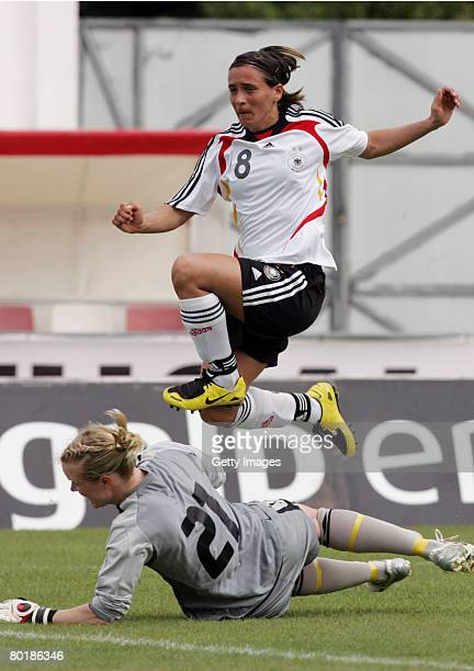 Sandra Smisek of Germany is challenged by Hedvig Lindahl of Sweden during the Women Algarve Cup match between Germany and Sweden on March 10 2008 in...