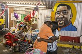 Sandra Sterling Alton Sterling's aunt visits his memorial at the Triple S Food Mart July 7 2016 in Baton Rouge Louisiana Sterling was shot by a...