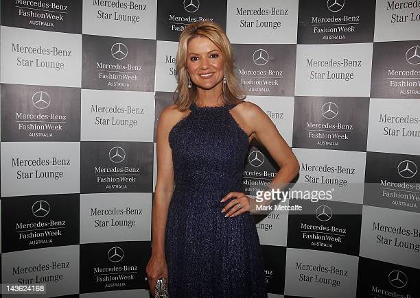 Sandra Sully poses at the Johanna Johnson show after party at the MercedesBenz Star Bar on day two of MercedesBenz Fashion Week Australia...