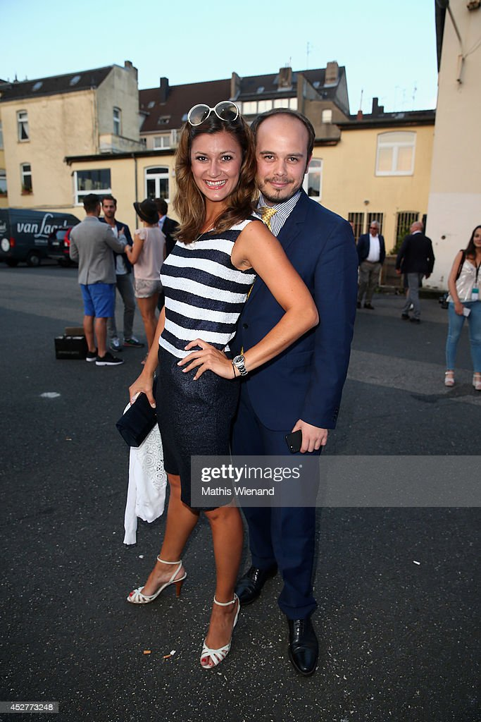 Sandra Thier and friend Benjamin Bartz attends the Van Laack Show at Platform Fashion on July 26, 2014 in Duesseldorf, Germany.