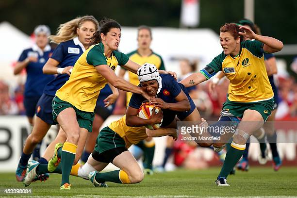 Sandrine Agricole of France is tackled by Ashleigh Hewson of Australia during the IRB Women's Rugby World Cup Pool C match between Australia and...