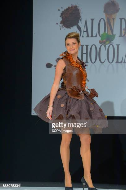 Sandrine Arcizet wearing the dress of Angelique Godey and Stephane Bonnat during the 23nd Chocolate Fair 2017 fashion show in Paris