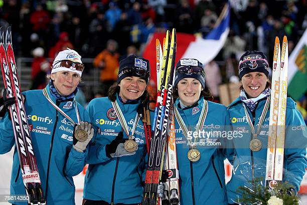 Sandrine Bailly Delphine Peretto Marie Laure Brunet and Sylvie Becaert of team France celebrate 3rd place during the IBU Biathlon World championships...