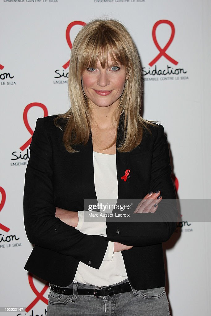 Sandrine Corman poses during the Sidaction 2013 - Photocall at Musee du Quai Branly on March 11, 2013 in Paris, France.