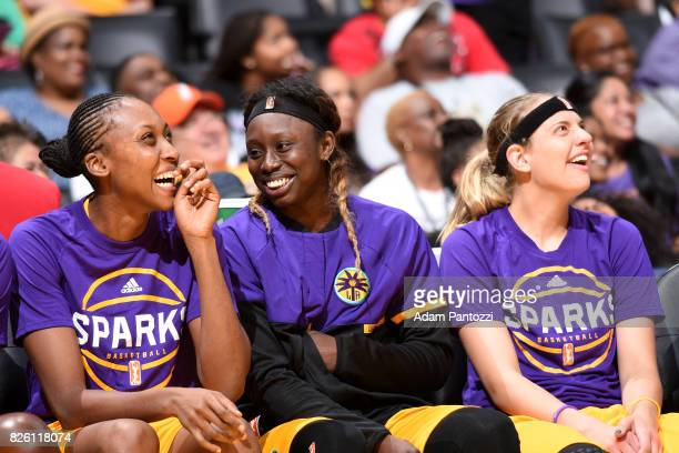 Sandrine Gruda Essence Carson and Sydney Wiese of the Los Angeles Sparks look on during the game against the Dallas Wings on July 30 2017 at STAPLES...