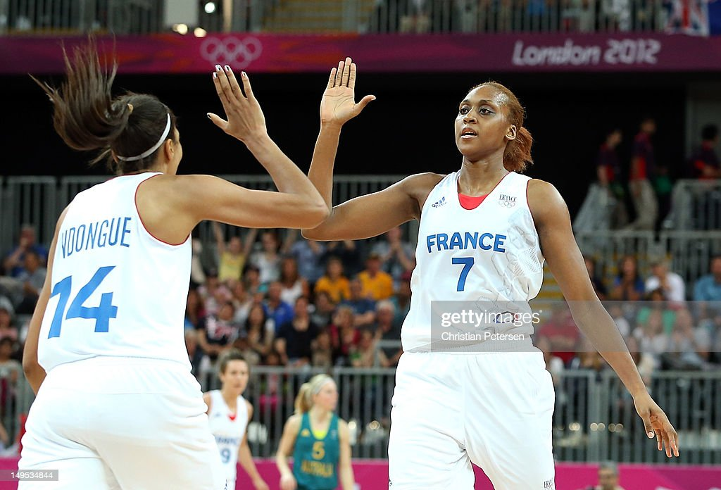 <a gi-track='captionPersonalityLinkClicked' href=/galleries/search?phrase=Sandrine+Gruda&family=editorial&specificpeople=711208 ng-click='$event.stopPropagation()'>Sandrine Gruda</a> #7 of France high-fives Emmeline Ndongue #14 after scoring against Australia during the Women's Basketball Preliminary Round match on Day 3 at Basketball Arena on July 30, 2012 in London, England.