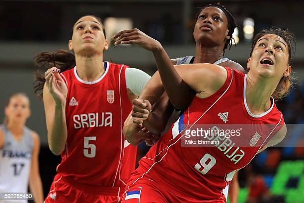 Sandrine Gruda of France Sonja Petrovic of Serbia and Jelena Milovanovic of Serbia look on during the Women's Bronze Medal basketball game between...