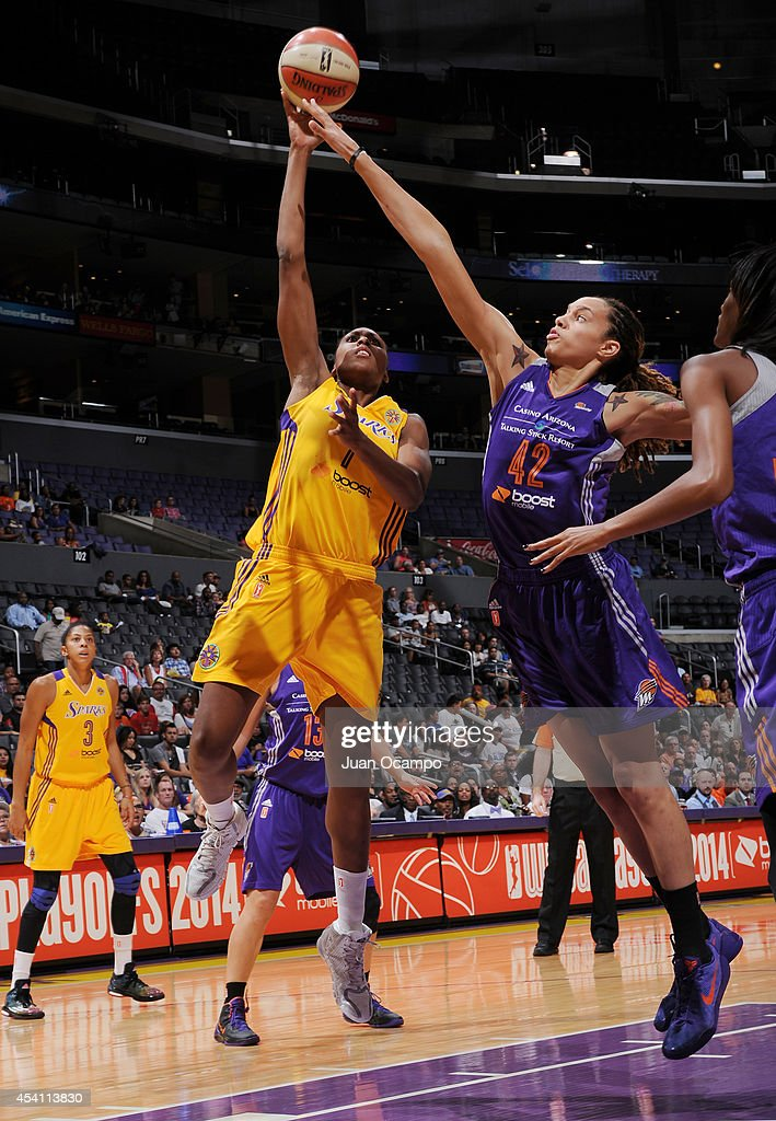 <a gi-track='captionPersonalityLinkClicked' href=/galleries/search?phrase=Sandrine+Gruda&family=editorial&specificpeople=711208 ng-click='$event.stopPropagation()'>Sandrine Gruda</a> #7 of the Los Angeles Sparks drives to the basket against <a gi-track='captionPersonalityLinkClicked' href=/galleries/search?phrase=Brittney+Griner&family=editorial&specificpeople=6836945 ng-click='$event.stopPropagation()'>Brittney Griner</a> #42 of the Phoenix Mercury in Game Two of the Western Conference Semifinals during the 2014 WNBA Playoffs on August 24, 2014 at STAPLES Center in Los Angeles, California.