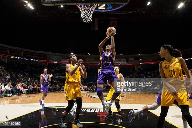 Sandrine Gruda of the Los Angeles Sparks shoots against Vicki Baugh of the Tulsa Shock during the WNBA game on June 28 2014 at the BOK Center in...