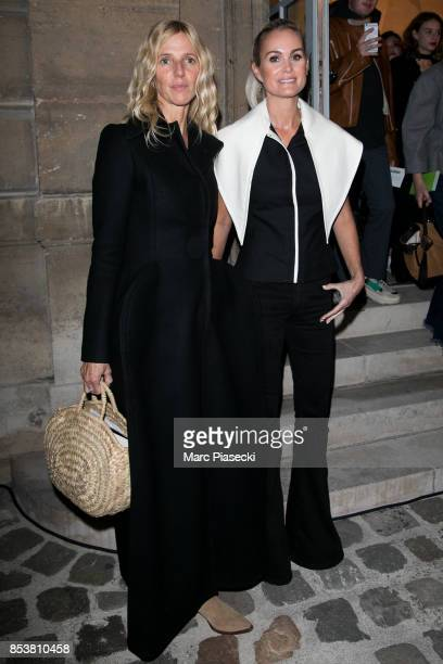 Sandrine Kiberlain and Laeticia Hallyday attend the Jacquemus show as part of the Paris Fashion Week Womenswear Spring/Summer 2018 on September 25...