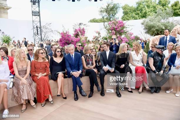 Sandrine KiberlainMarisa BersonNathalie PortmanBernard ArnaultHelene MercierRobert Pattinson and Delphine Arnault attend the Christian Dior Haute...