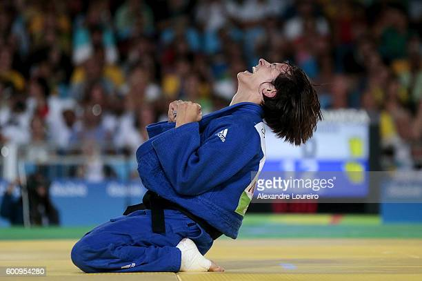 Sandrine Martinet of France celebrates the victory against Ramona Brussig of Germany after the women's 52 kg gold medal match on Day 1 of the Rio...