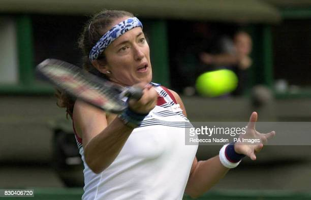 Sandrine Testud of France in action against Russia's Anna Kournikova during the first day of the Lawn Tennis Championships at Wimbledon