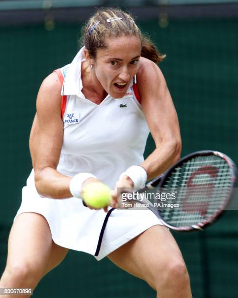 Sandrine Testud of France in action against USA's Jennifer Capriati during their Fourth Round match of the 2001 Lawn Tennis Championships at...