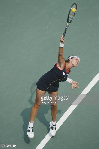 Sandrine Testud of France serves to Martina Hingis during their Women's Singles fourth round match at the US Open Tennis Championship on 4 September...