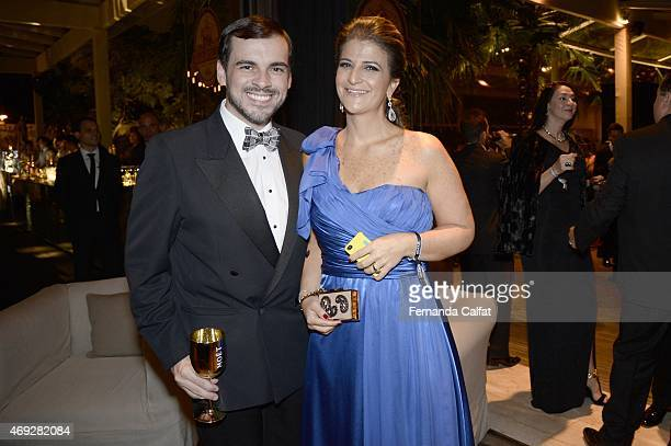 Sandro Barros and Flavia attends the 5th Annual amfAR Inspiration Gala at the home of Dinho Diniz on April 10 2015 in Sao Paulo Brazil