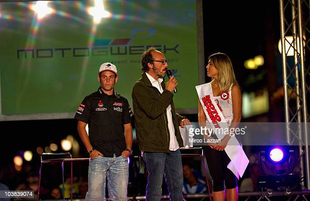 Sandro Cortese of Germany and Avant Mitsubishi Ajo looks on while the italian journalist Guido Meda speaks with the girl during the preevent MotoGP...