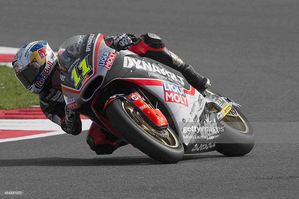 <a gi-track='captionPersonalityLinkClicked' href=/galleries/search?phrase=Sandro+Cortese&family=editorial&specificpeople=2206207 ng-click='$event.stopPropagation()'>Sandro Cortese</a> of Germany and Dynavolt Intact GP rounds the bend during the MotoGp Of Great Britain - Free Practice at Silverstone Circuit on August 29, 2014 in Northampton, United Kingdom.