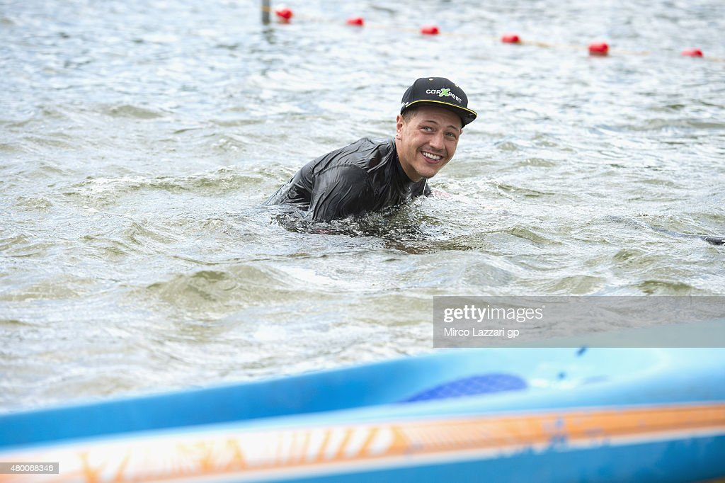 <a gi-track='captionPersonalityLinkClicked' href=/galleries/search?phrase=Sandro+Cortese&family=editorial&specificpeople=2206207 ng-click='$event.stopPropagation()'>Sandro Cortese</a> of Germany and Dynavolt Intact GP smiles during the pre-event 'Stand Up paddle race at the Stausse Oberwald Lake' during the MotoGp of Germany - Previews at Sachsenring Circuit on July 9, 2015 in Hohenstein-Ernstthal, Germany.