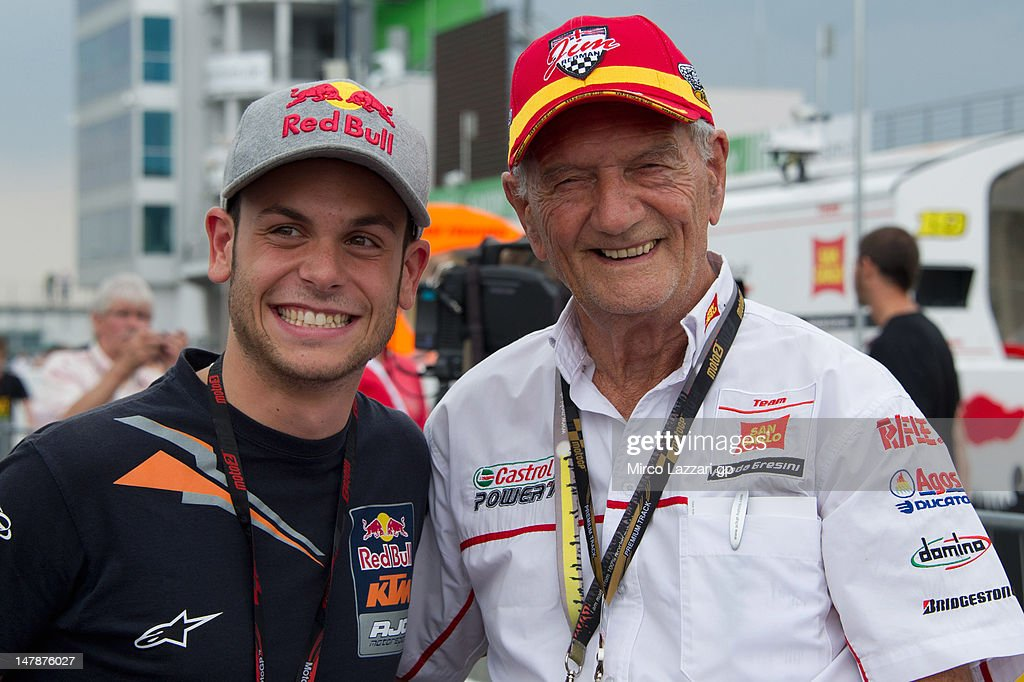 Sandro Cortese of Germany and Red Bull KTM Ajo and Jim Redman of Great Britain pose on the grid during the pre-event 'MotoGP riders celebrate Sachsenring's 85th Anniversary' during the MotoGp of Germany at Sachsenring Circuit on July 5, 2012 in Hohenstein-Ernstthal, Germany.