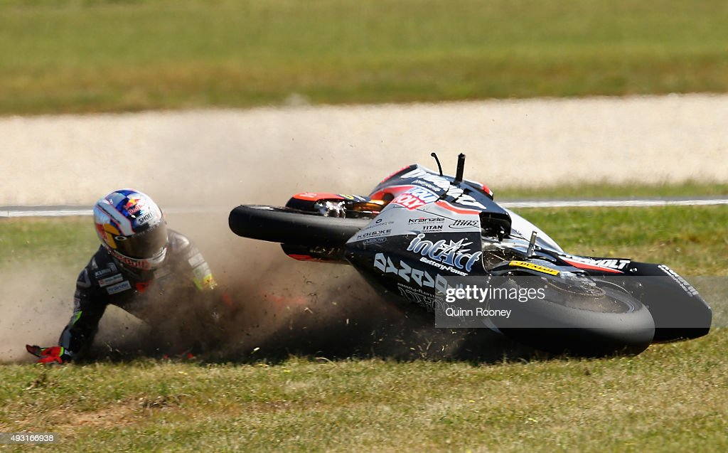 <a gi-track='captionPersonalityLinkClicked' href=/galleries/search?phrase=Sandro+Cortese&family=editorial&specificpeople=2206207 ng-click='$event.stopPropagation()'>Sandro Cortese</a> of Germany and the Dynavolt Intact GP crashes during the Moto3 Race before the 2015 MotoGP of Australia at Phillip Island Grand Prix Circuit on October 18, 2015 in Phillip Island, Australia.