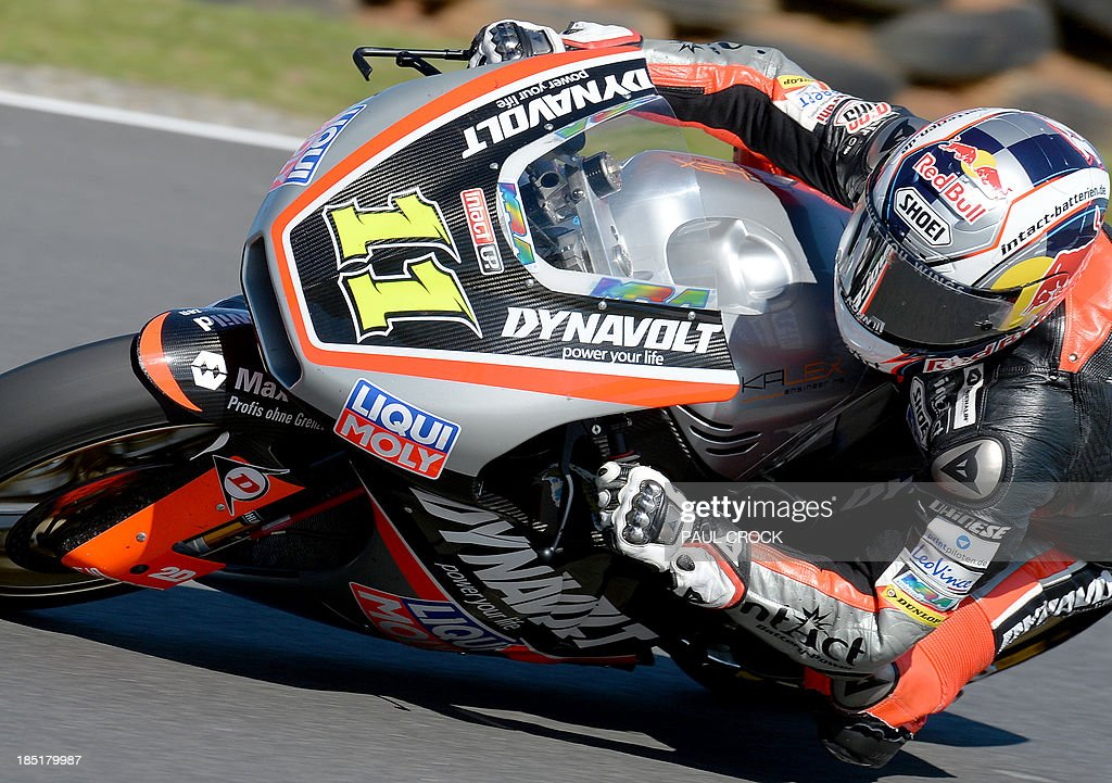 Sandro Cortese of Germany races his Kalex through a corner during practice for the Australian Moto2 Grand Prix at Phillip Island on October 18, 2013. AFP PHOTO/Paul Crock USE