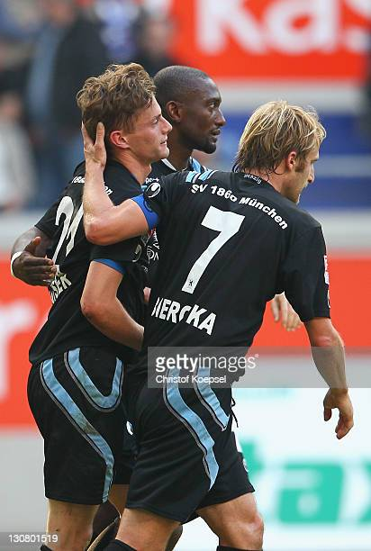Sandro Kaiser of Muenchen celebrates the second goal with Collin Benjamin and Daniel Bierofka during the Second Bundesliga match between MSV Duisburg...