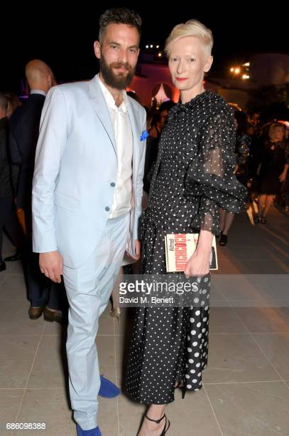 Sandro Kopp and Tilda Swinton attend the Vanity Fair and Chopard Party celebrating the Cannes Film Festival at Hotel du CapEdenRoc on May 20 2017 in...