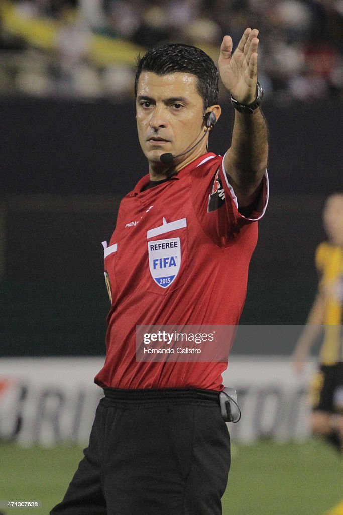 Sandro Meira Ricci referee gestures during a first leg match between Guarani and Racing Club as part of quarterfinals of Copa Bridgestone Libertadores 2015 at Defensores del Chaco Stadium on May 21, 2015 in Asuncion, Paraguay.