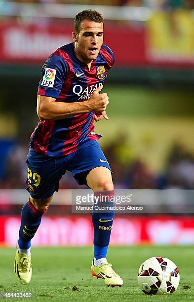 Sandro of Barcelona runs with the ball during the La Liga match between Villarreal CF and FC Barcelona at El Madrigal stadium on August 31 2014 in...