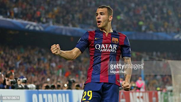 Sandro of FC Barcelona celebrates the third goal during the UEFA Champions League match between FC Barcelona and AFC Ajax on October 21 2014 in...