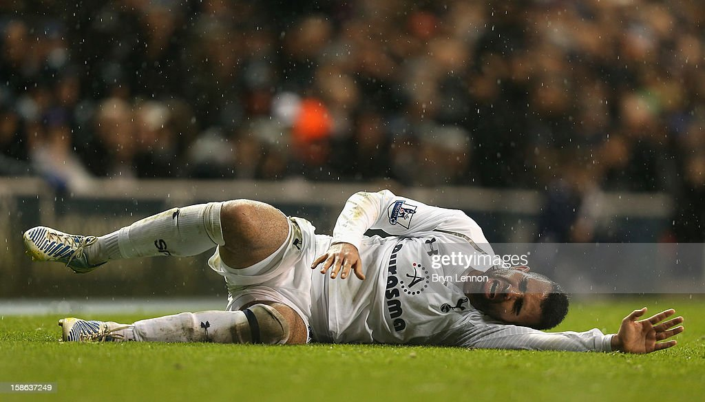 Sandro of Tottenham Hotspur lies injured on the pitch during the Barclays Premier League match between Tottenham Hotspur and Stoke City at White Hart Lane on December 22, 2012 in London, England.