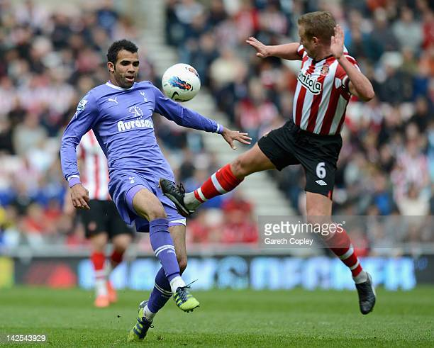 Sandro of Tottenham is tackled by Lee Cattermole of Sunderland during the Barclay's Premier League match between Sunderland and Tottenham Hotspur at...