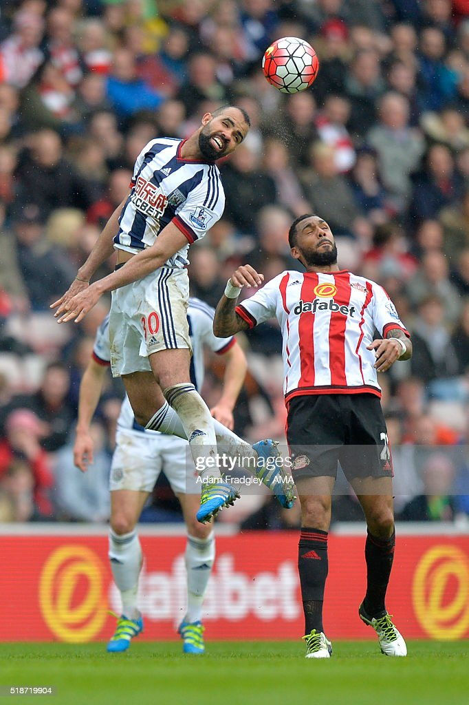 Sandro of West Bromwich Albion competes with Yann M'Vila of Sunderland during the Barclays Premier League match between Sunderland and West Bromwich Albion at Stadium of Light on April 2, 2016 in Sunderland, England.