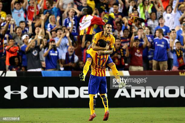 Sandro Ramirez of Barcelona celebrates a goal with teammate Rafinha against Chelsea in the second half during the International Champions Cup North...