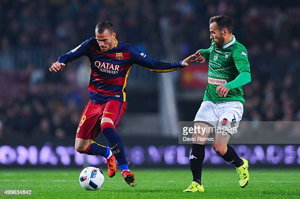 Sandro Ramirez of FC Barcelona competes for the ball with Moraga of Villanovense during the Copa del Rey Round of 32 second leg match betwen FC...