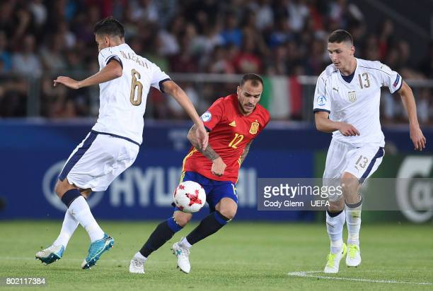 Sandro Ramrez of Spain and Lorenzo Pellegrini and Mattia Caldara of Italy during their UEFA European Under21 Championship 2017 semifinal match on...