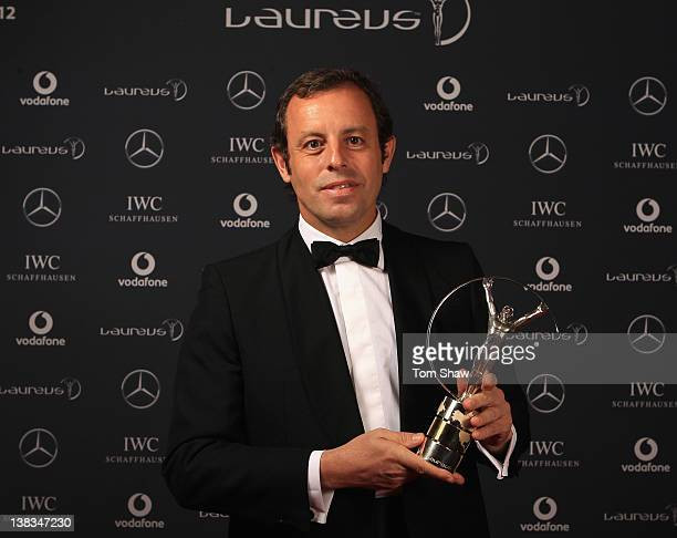 Sandro Rosell the Barcelona FC Chairman with the trophy for winners of the Laureus World Team of the Year poses in the Winners Studio during the 2012...