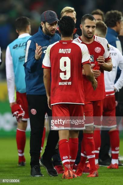 Sandro Schwarz coach of Mainz shakes hands with Yoshinori Muto of Mainz after the Bundesliga match between Borussia Moenchengladbach and 1 FSV Mainz...